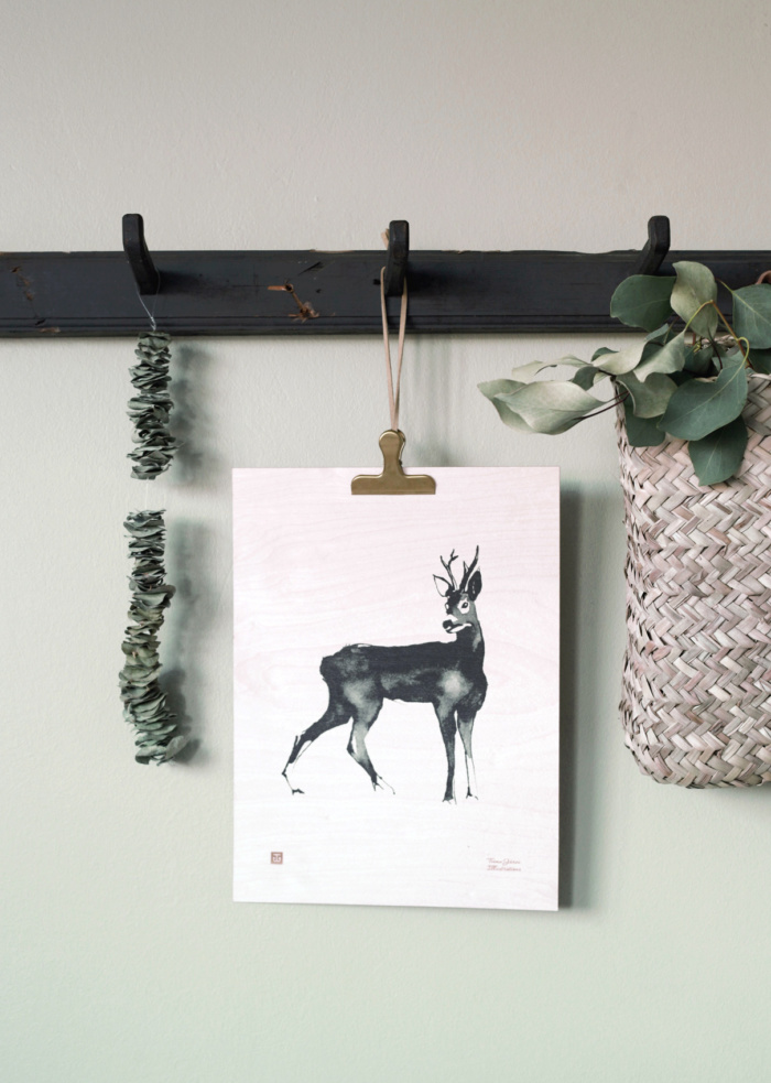 The elegant roe deer is captured on a plywood poster, a special art piece that brings the feeling of forest to your home.