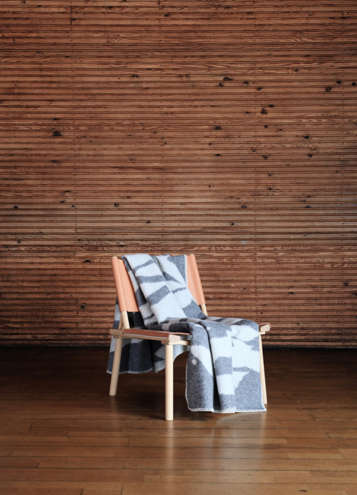 The soft and stylish Whitewater wool blanket is inspired by rushing waters