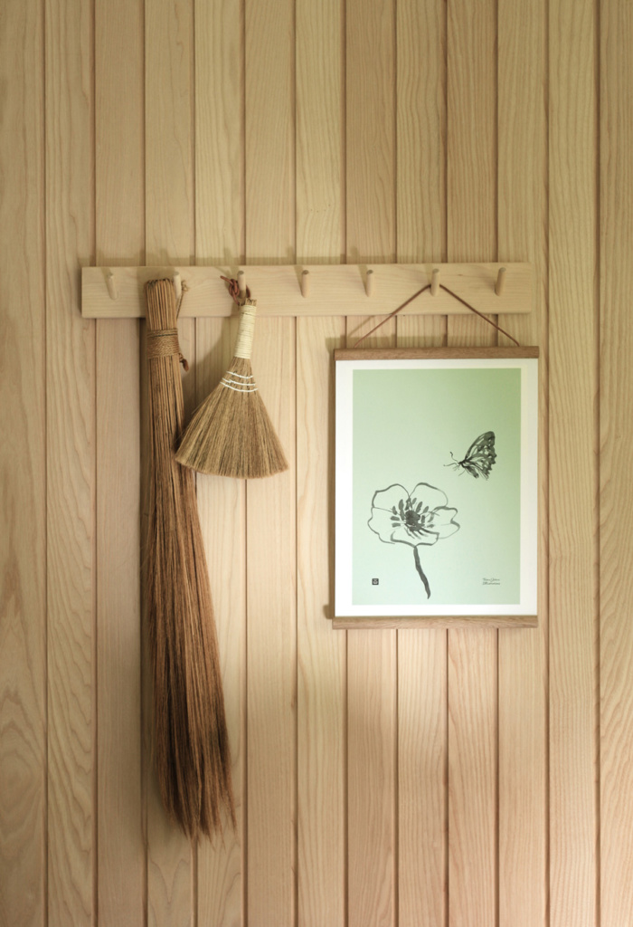 Spring green butterfly wall decor on a wooden frame