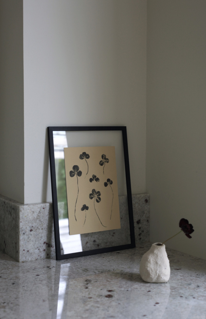 Clover mini art print on a black frame